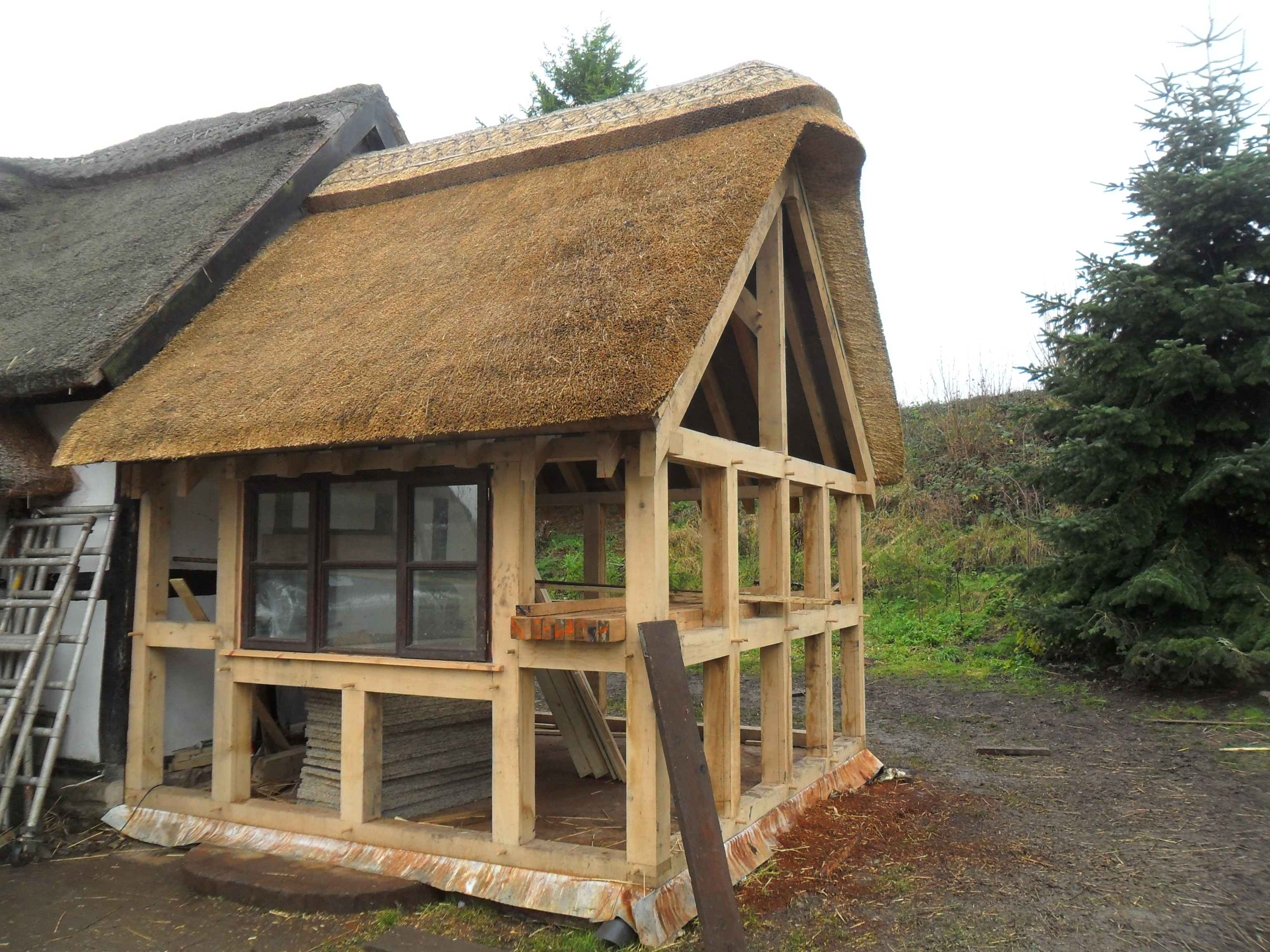 Oak extension for thatch roof